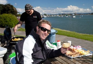 Ex-All Black Justin Enjoys A Lunch Of Local Delicacies On The Whakatane River.